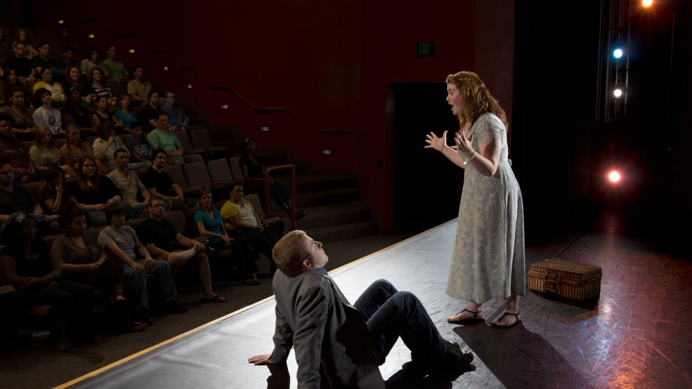 Theater students preforming in front of an audience