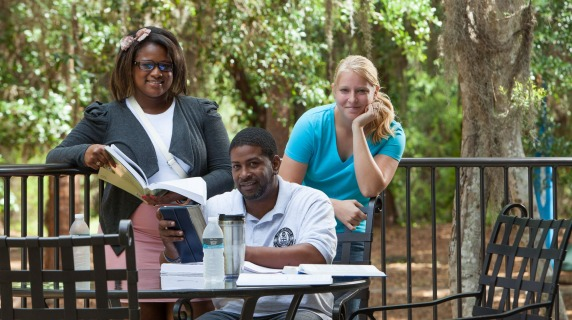 group of students in an outside patio studying