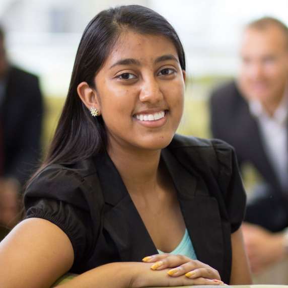 Female business student smiling at camera