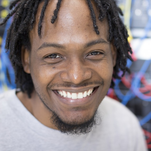 African American male engineering student smiling at camera