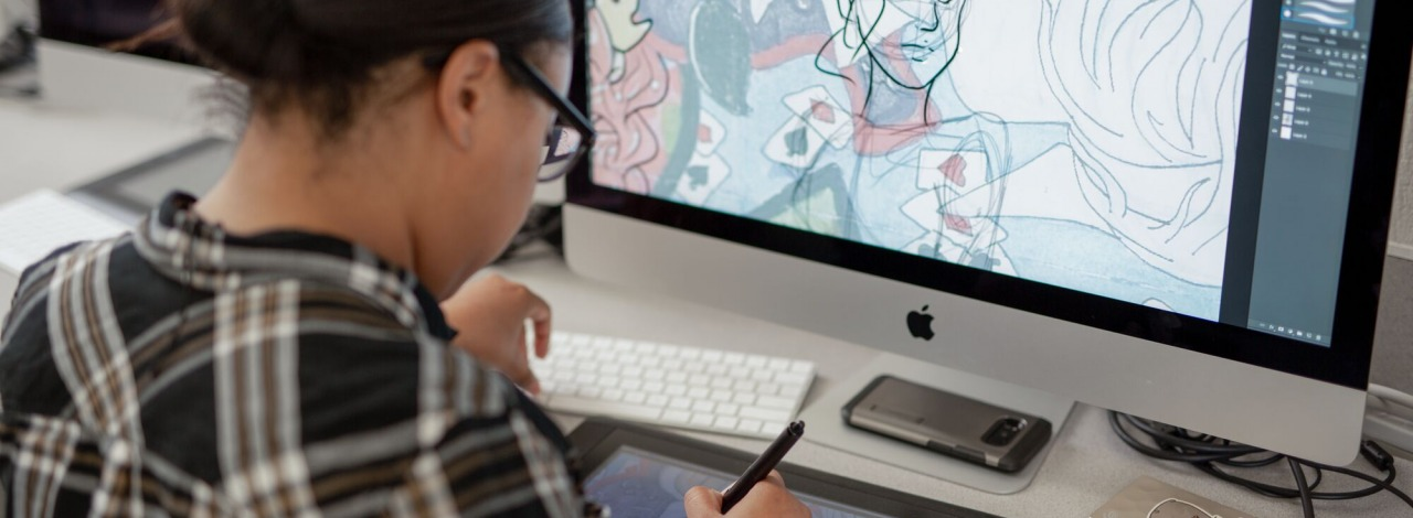 Close-up of a student drawing on a graphic tablet